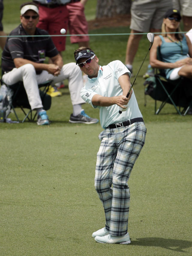 Ian Poulter, of England, chips to the second green during the second round of the Masters golf tournament Friday, April 11, 2014, in Augusta, Ga. (AP Photo/Chris Carlson)