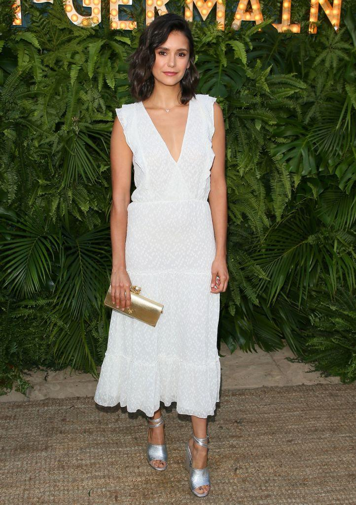 <p>Nina Dobrev wears a white Altuzarra dress to the second annual Maison St-Germain on July 10, 2018, in Malibu, Calif. (Photo: JB Lacroix/ WireImage) </p>