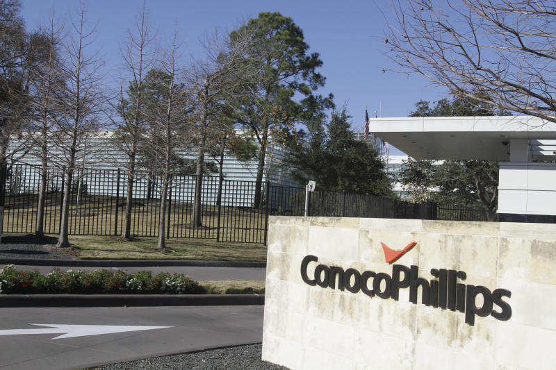 A sign is displayed outside the ConocoPhillips corporate headquarters Tuesday, Jan. 25, 2011, in Houston. ConocoPhillips said Wednesday, Jan. 26, its fourth-quarter earnings jumped 54 percent despite a drop in production as crude prices increased. (AP Photo/Pat Sullivan)
