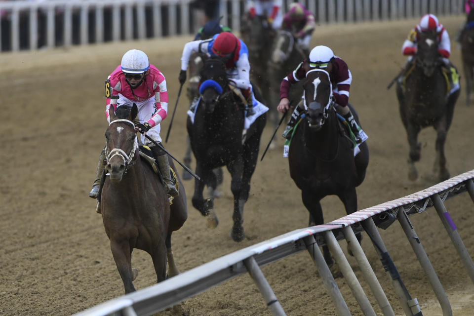 Flavien Prat atop Rombauer, left, wins the 146th Preakness Stakes horse race at Pimlico Race Course, Saturday, May 15, 2021, in Baltimore. (AP Photo/Will Newton)