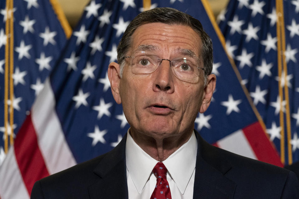 """FILE - In this June 8, 2021, file photo, Sen. John Barrasso, R-Wyo., speaks with reporters after a Republican caucus luncheon on Capitol Hill in Washington. Barrasso said Friday, June 11, 2021, that U.S. Bureau of Land Management nominee Tracy Stone-Manning should be disqualified over her links to """"extreme environmental activists"""" when Manning was a graduate student in the 1980s. (AP Photo/Alex Brandon, File)"""