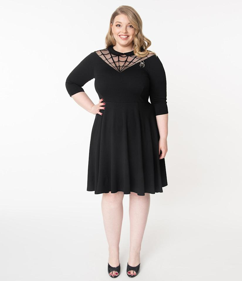 """<p>This <product href=""""https://www.unique-vintage.com/products/unique-vintage-plus-size-black-spiderweb-endora-fit-flare-dress"""" target=""""_blank"""" class=""""ga-track"""" data-ga-category=""""Related"""" data-ga-label=""""https://www.unique-vintage.com/products/unique-vintage-plus-size-black-spiderweb-endora-fit-flare-dress"""" data-ga-action=""""In-Line Links"""">Unique Vintage Plus Size Black Spiderweb Endora Fit and Flare Dress</product> ($88) is charming and subtle. </p>"""