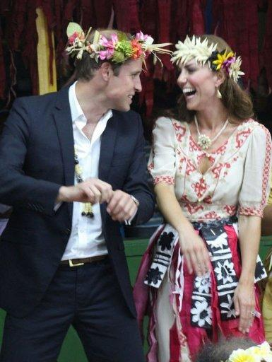<p>Prince William (L) and his wife Catherine dance during a 'fatale', a singing and dancing event in Tuvalu on September 18, 2012. French authorities on Tuesday banned Closer magazine from any further distribution of the pictures of Catherine topless and began a criminal probe into how they were obtained.</p>