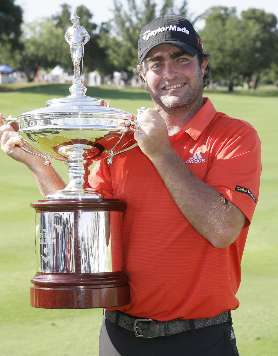 Steven Bowditch holds the trophy after winning the Byron Nelson golf tournament, Sunday, May 31, 2015, in Irving, Texas. Bowditch won with a 16-under. (AP Photo/LM Otero)