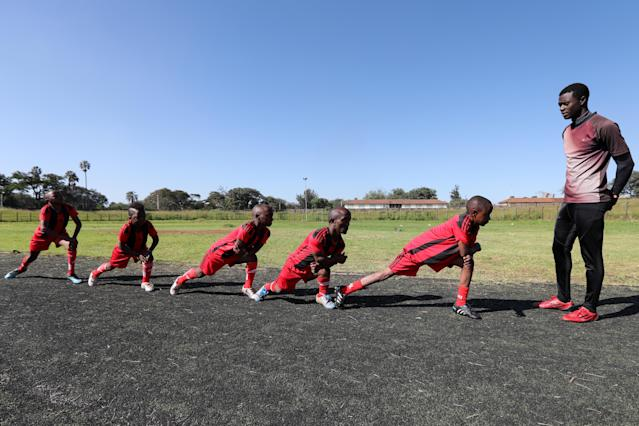 XDI11. Nairobi (Kenya), 29/05/2018.- Players of Lion Stars, Kenya's first dwarf soccer team, warm up during a training session under the direction of their coach Gabriel Ochieng (R) at the City Stadium in Nairobi, Kenya, 29 May 2018 (issued 14 July 2018). Lion Stars is an eight member men's dwarf soccer team, the first of their kind in Kenya, with players aged between 18 and 47 years old. Led by Gabriel Ochieng, a volunteer coach, the team aims transition from a recreational to a competitive one. They are planning to head to Argentina for the Copa Argentina tournament in October 2018 for friendly matches they have been invited to. Dwarf soccer has different rules to the mainstream version, in the interests of player safety. Headers are banned, for instance, to prevent spinal injuries, and if a player heads the ball, the other team will be awarded a free kick. Lion Stars is the only dwarf soccer team in East Africa and is working towards bringing Tanzania, Uganda and Rwanda into the fold. However, the team is facing several challenges, including financial sponsorship that would enable them to further their sporting endeavors. 'We face the challenge of ground, we face a challenge of balls, we face challenge of corns, we face challenge of uniform,' volunteer coach Ochieng said. They have reached out to the Kenyan government and well-wishers for help. The team was established with the help of the 'Short Stature Society of Kenya' to help counter stigmatization against people of short stature in the country by engaging in activities such as motivational speaking, theater, and community work as well as sporting activities such as weight-lifting, badminton and soccer. (Futbol, Amistoso, Kenia, Ruanda) EFE/EPA/DANIEL IRUNGU ATTENTION: This Image is part of a PHOTO SET