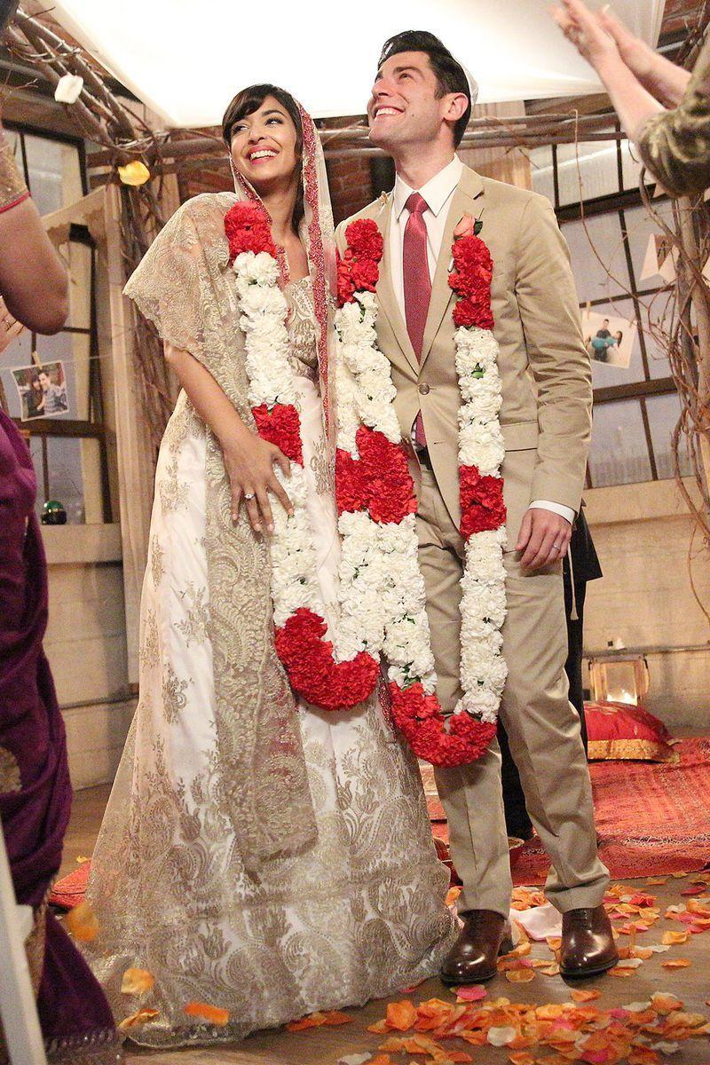 <p>When Cece and Schmidt finally tie the knot on <em>New Girl</em>, Cece wore a pretty gold sari and a red-and-white flower garland, while Schmidt wore a tan suit to match. </p>