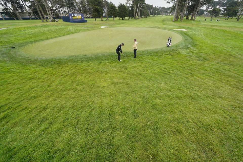 Matthias Schwab chips to the green on the fourth hold during a practice round for the PGA Championship golf tournament at TPC Harding Park Wednesday, Aug. 5, 2020, in San Francisco. (AP Photo/Charlie Riedel)