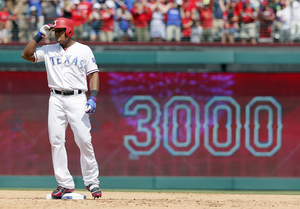 Texas Rangers' Adrian Beltre tips his helmet as he acknowledges cheers after hitting a double for his 3,000th career hit that came off a pitch from Baltimore Orioles' Wade Miley in the fourth inning of a baseball game, Sunday, July 30, 2017, in Arlington, Texas.
