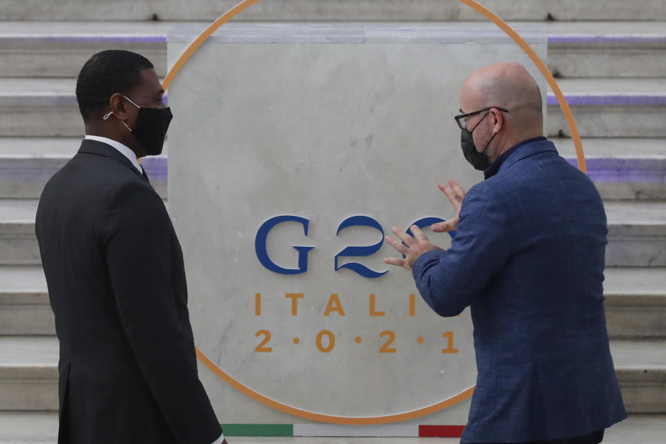 Administrator of the Environmental Protection Agency Michael Stanley Regan, left, is welcomed by Italian Minister for Ecological Transition Roberto Cingolani as he arrives at Palazzo Reale in Naples, Italy, Thursday, July 22, 2021, to take part in a G20 meeting on environment, climate and energy. (AP Photo/Salvatore Laporta)