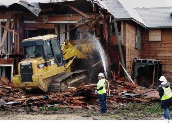 Lee Harvey Oswald's Dallas apartment is demolished by a bulldozer