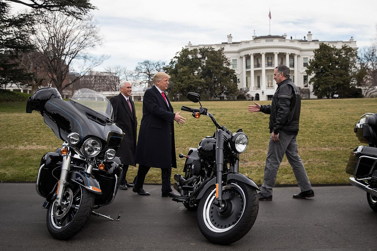 President Donald Trump (center) greets Matthew Levatich (right), CEO of Harley-Davidson Inc., outside the White House in February 2017 as Vice President Mike Pence smiles. (Photo: Drew Angerer/Bloomberg via Getty Images)