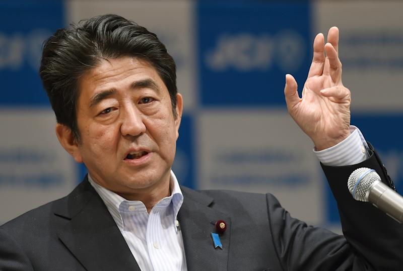 Japanese Prime Minister Shinzo Abe delivers a speech during a conference in Yokohama on July 20, 2014 (AFP Photo/Toru Yamanaka)