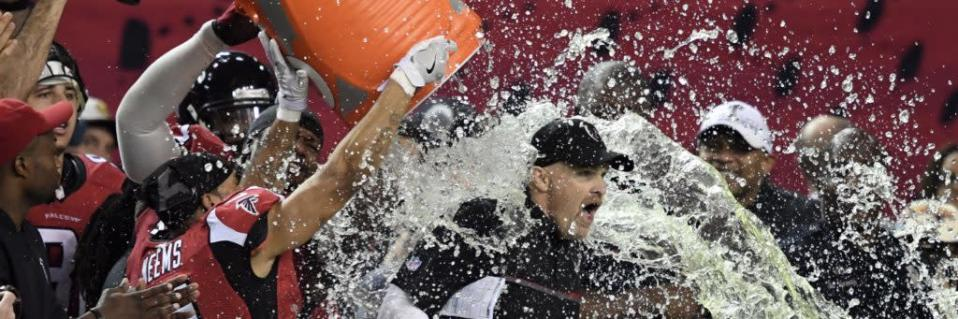 Jan 22, 2017; Atlanta, GA, USA; Atlanta Falcons wide receiver Eric Weems (14) dumps gatorade on head coach Dan Quinn during the fourth quarter in the 2017 NFC Championship Game against the Green Bay Packers at the Georgia Dome. Atlanta won 44-21. Mandatory Credit: John David Mercer-USA TODAY Sports