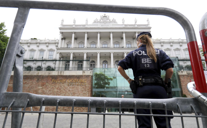 Police waits in front of Palais Coburg where closed-door nuclear talks with Iran take place in Vienna, Austria, Friday, July 6, 2018. (AP Photo/Ronald Zak)