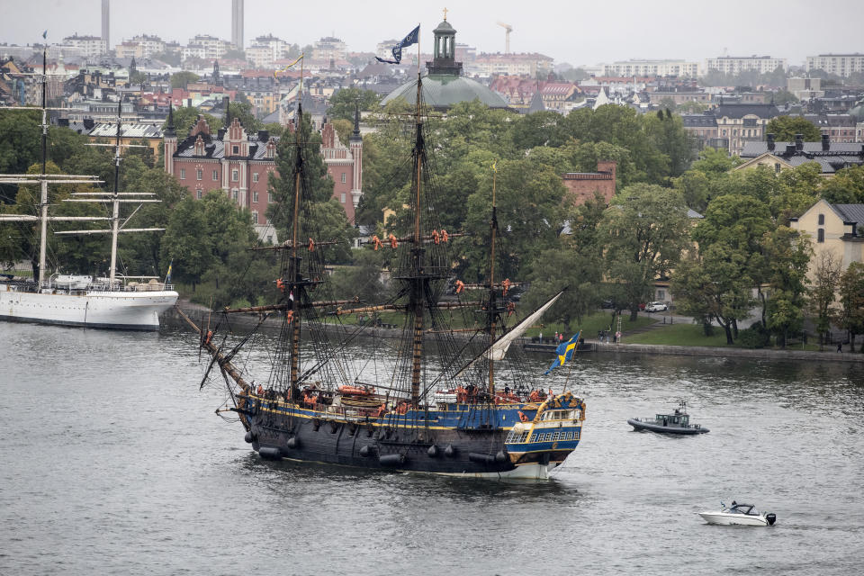 A full-size replica of a 18th century, three-mast, ocean-going wooden tall galleon that sank in 1745, enters Stockholm on Thursday, Aug. 26, 2021 on its first stop on its second journey to Asia that the ship will make next year. In 1745, the original merchant ship that had more than 130 men on board, ran aground and sank outside her home port of Goteborg, Sweden's second largest city, as it approached the harbor as it returned from its third voyage to China. (Christine Olsson/TT News Agency via AP)