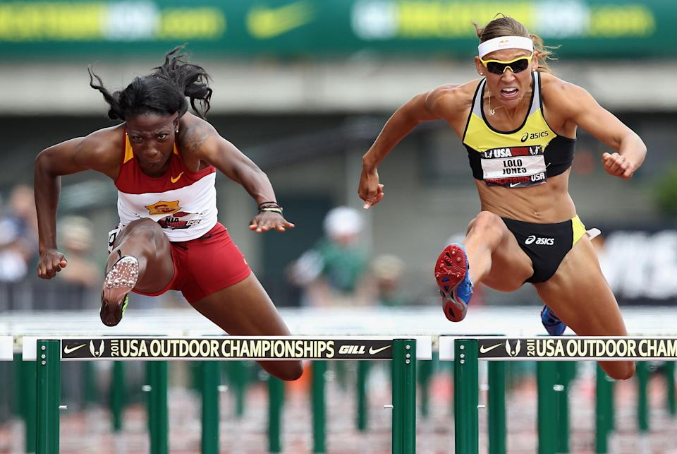 (L-R) Nia Ali and Lolo Jones compete in the Women's 100 meter hurdles semi-final on day four of the USA Outdoor Track & Field Championships at the Hayward Field on June 26, 2011 in Eugene, Oregon. (Photo by Christian Petersen/Getty Images)