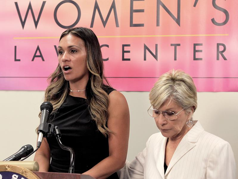 Sen. Barbara Boxer, D-Calif., right joins former U.S. Marine and survivor of military sexual assault Stacey Thompson at a news conference at the California Women's Law Center in Los Angeles on Friday May 31, 2013. Senator Boxer came to discuss her bipartisan legislation to address the epidemic of military sexual assault by ensuring that decisions to prosecute these crimes are made by trained military prosecutors. (AP Photo/Richard Vogel)