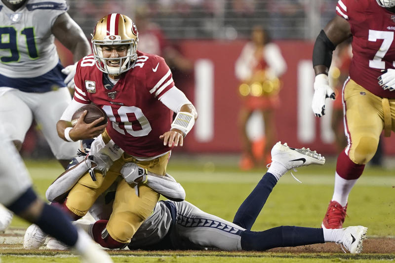 San Francisco 49ers quarterback Jimmy Garoppolo (10) is sacked by Seattle Seahawks cornerback Tre Flowers during the first half of an NFL football game in Santa Clara, Calif., Monday, Nov. 11, 2019. (AP Photo/Tony Avelar)