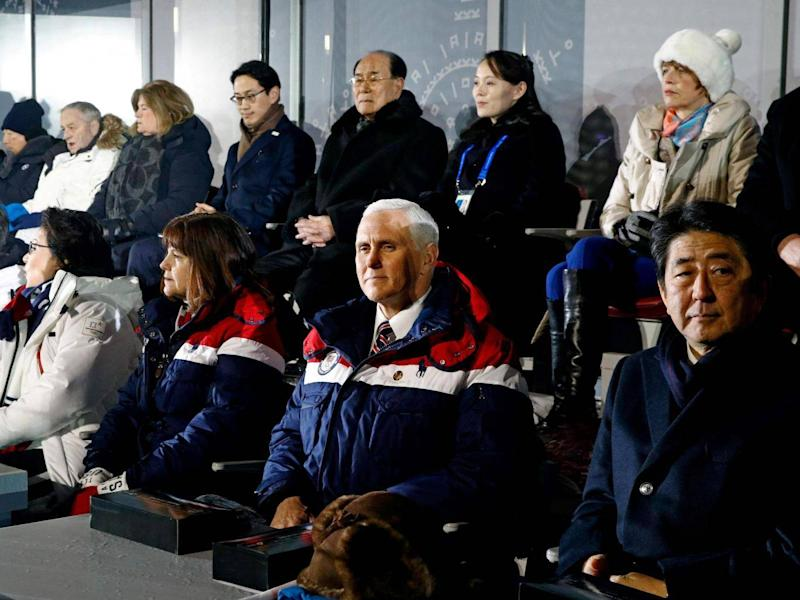Mike Pence (front 2nd right) sits just feet from Kim Jong-un's sister Kim Jo-yong (back 2nd right) (AFP/Getty)
