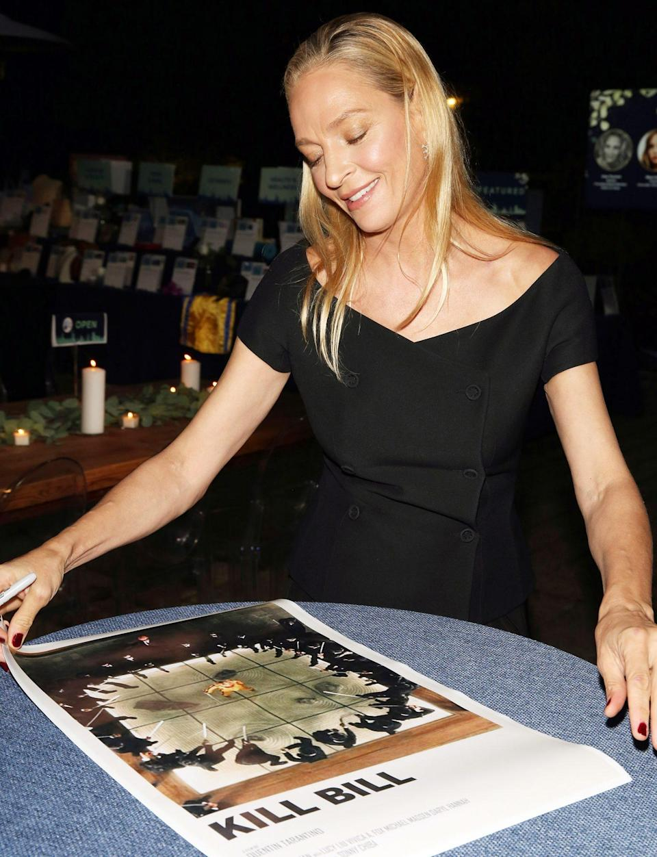 <p>Uma Thurman looks upon a <em>Kill Bill</em> poster at the Room to Grow Annual Benefit at The Foundry in Queens, New York on Oct. 13.</p>