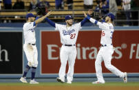 From left, Los Angeles Dodgers' Chris Taylor, Alex Verdugo and Cody Bellinger celebrate after a win over the Atlanta Braves during a baseball game Wednesday, May 8, 2019, in Los Angeles. (AP Photo/Marcio Jose Sanchez)