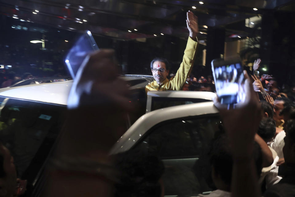 President of the Shiv Sena party Uddhav Thackeray waves to supporters as he leaves after he was elected to lead the Shiv Sena, Congress party and Nationalist Congress Party (NCP) alliance in Mumbai, India, Tuesday, Nov. 26, 2019. (AP Photo/Rafiq Maqbool)