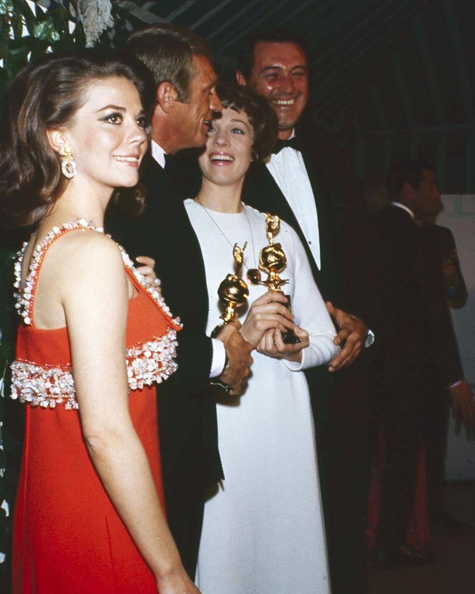 <p>Natalie Wood went with a chic red gown with shimmery embellishments for the 1967 awards. </p>