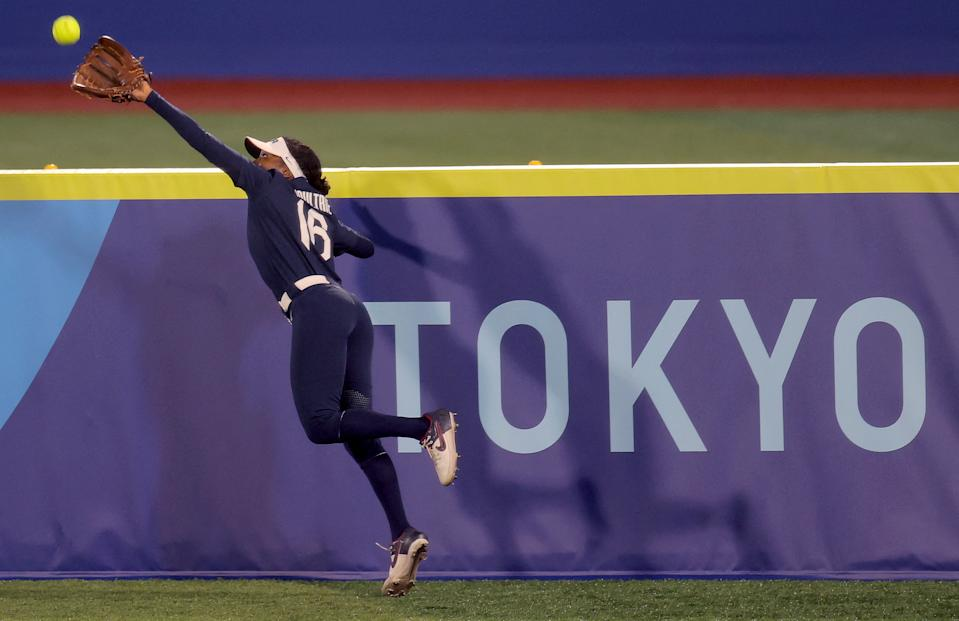 Team USA's right fielder Michelle Moultrie reeled in this shot, but the USA couldn't overcome Japan in the gold medal game. (Kazuhiro Fujihara/AFP via Getty Images)