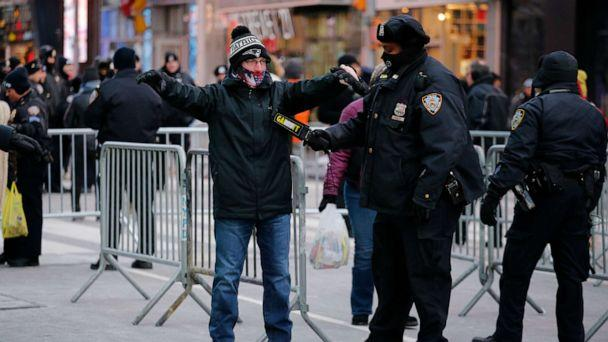 PHOTO: A New York Police Department officer checks a reveler in Times Square prior to New Year's Eve celebrations on Dec. 31, 2017, in New York. (Kena Betancur/AFP via Getty Images, FILE)