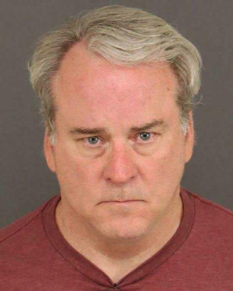 This undated photo provided by the Colorado Springs Police Department shows Michael Whyte, 58, of Thornton, Colo., who was arrested Thursday, June 13, 2019, on suspicion of first-degree murder. Police say DNA evidence led them to identify Whyte as a suspect in the 1987 strangulation death of Darlene Krashoc, 20, a soldier at Fort Carson, Colo. (Colorado Springs Police Department via AP)