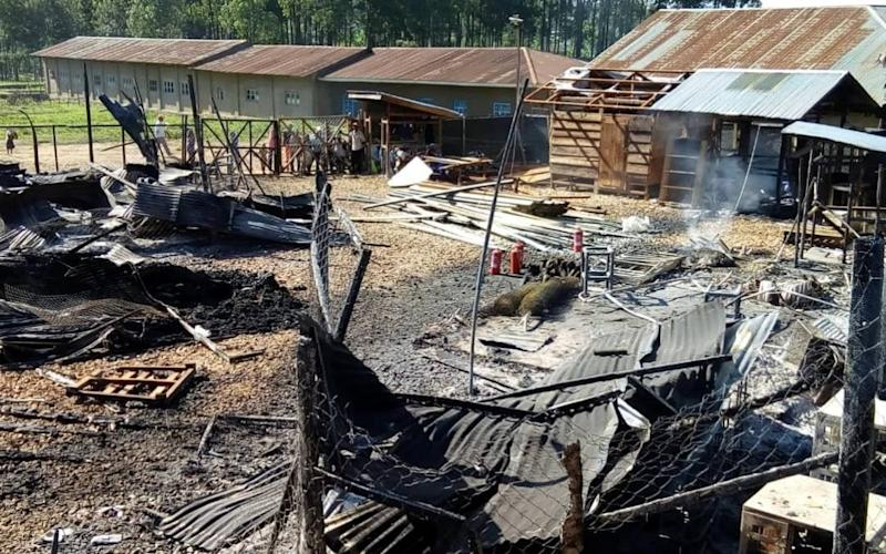 Burned structures after attackers set fire to an Ebola treatment center run by Medecins Sans Frontieres in Katwa February 25, 2019 - Laurie Bonnaud/MSF/REUTERS