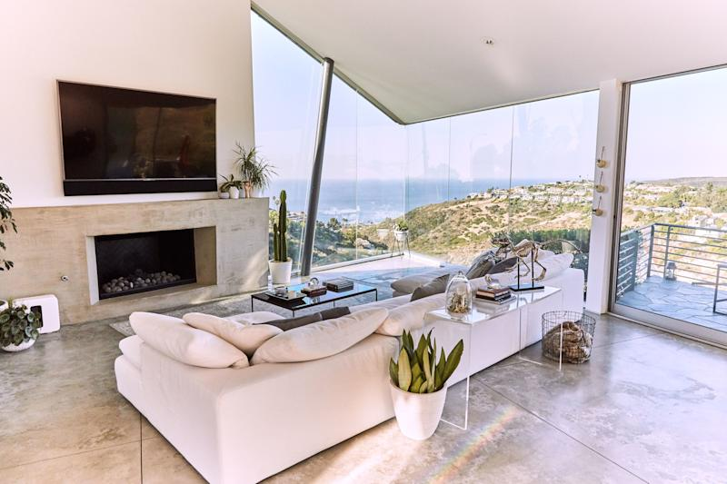 """Says Huston, """"There being a lot of big glass windows, a lot of good areas for the view"""" attracted him to this five-bedroom home, where he's already enjoyed some particularly spectacular sunsets. To complement the exposure to inspiring landscapes, he installed quite a few plants throughout the place. """"Someone comes to water them,"""" says the pro skateboarder. """"I was going to have my roommate try to do it, but it's too big a job."""""""