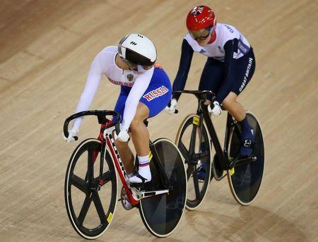 FILE PHOTO - Britain's Victoria Pendleton (R) and Russia's Ekaterina Gnidenko compete during the track cycling women's sprint 1/16 finals at the Velodrome during the London 2012 Olympic Games August 5, 2012. REUTERS/Stefano Rellandini