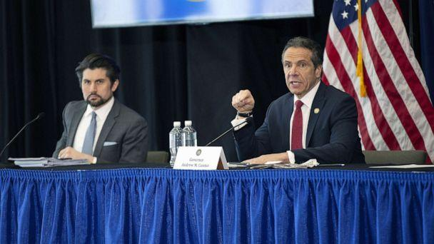 PHOTO: Jim Malatras, President of SUNY Empire State College, left, listens as New York State Governor Andrew Cuomo, right, speaks during his daily coronavirus press briefing at SUNY Upstate Medical University, April 28, 2020 in Syracuse, New York. (Stefani Reynolds/Getty Images)