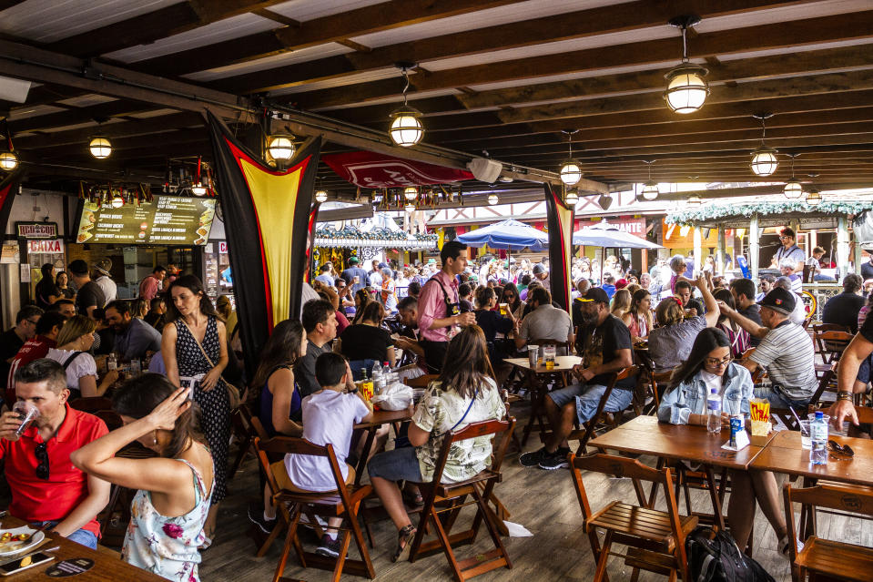 BLUMENAU, SANTA CATARINA, BRAZIL - 2018/10/20: People seen at the restaurant during the festival. Oktoberfest 2018 is a Germany beer festival in Blumenau, a Brazilian city founded by German immigrants. Blumenau, Santa Catarina, Brazil. (Photo by Ricardo Ribas/SOPA Images/LightRocket via Getty Images)