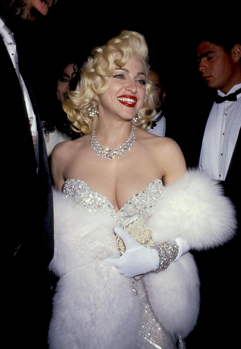 """Madonna was in Marilyn Monroe mode when she made a special appearance at the 1991 Oscars with Michael Jackson. Pop's king and queen both accessorized with massive diamonds—his brooch as bolero moment is iconic in itself—but Madonna's outsize bling proved record-breaking. With more than $20 million worth of Harry Winston jewels on her person, she brought the """"Diamonds Are a Girl's Best Friend"""" theme to life."""
