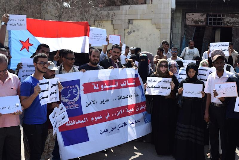 Yemenis gather on March 5, 2016 outside Aden's security department to protest against an attack on an elderly care home in the city (AFP Photo/Saleh Al-Obeidi)