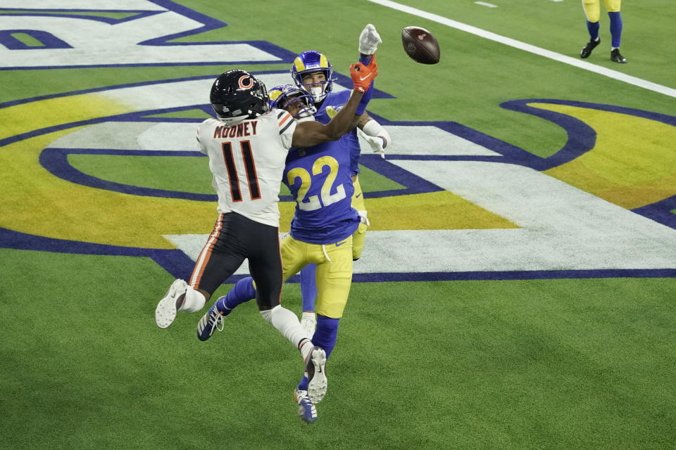 Los Angeles Rams cornerback Troy Hill (22) tips a pass in the end zone intended for Chicago Bears wide receiver Darnell Mooney (11) during the second half of an NFL football game Monday, Oct. 26, 2020, in Inglewood, Calif. The ball was caught by Rams safety Taylor Rapp, behind, for a touchback. (AP Photo/Ashley Landis )