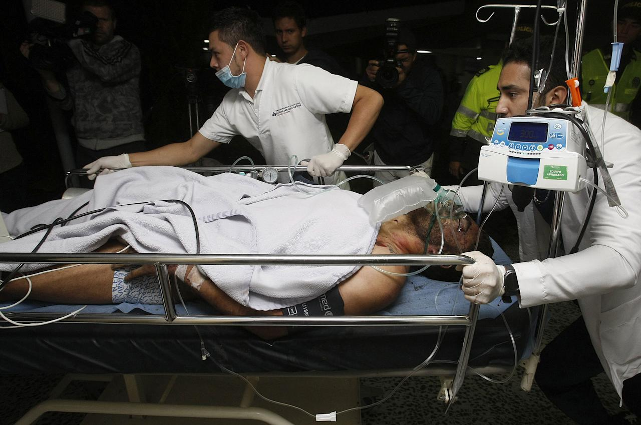 <p>Medical staff from the San Juan de Dios hospital transfer 27-year-old Brazilian soccer player Alan Ruschel as he arrives to La Ceja in Colombia on Nov. 29, 2016, after surviving a plane crash. Ruschel is said to be the first survivor after a plane reportedly carrying 81 people, including the players of the Brazilian soccer club Chapecoense, crashed in a mountainous area outside Medellin as it was approaching the Jose Maria Cordoba airport. (Lius Eduardo Noriega A./EPA) </p>