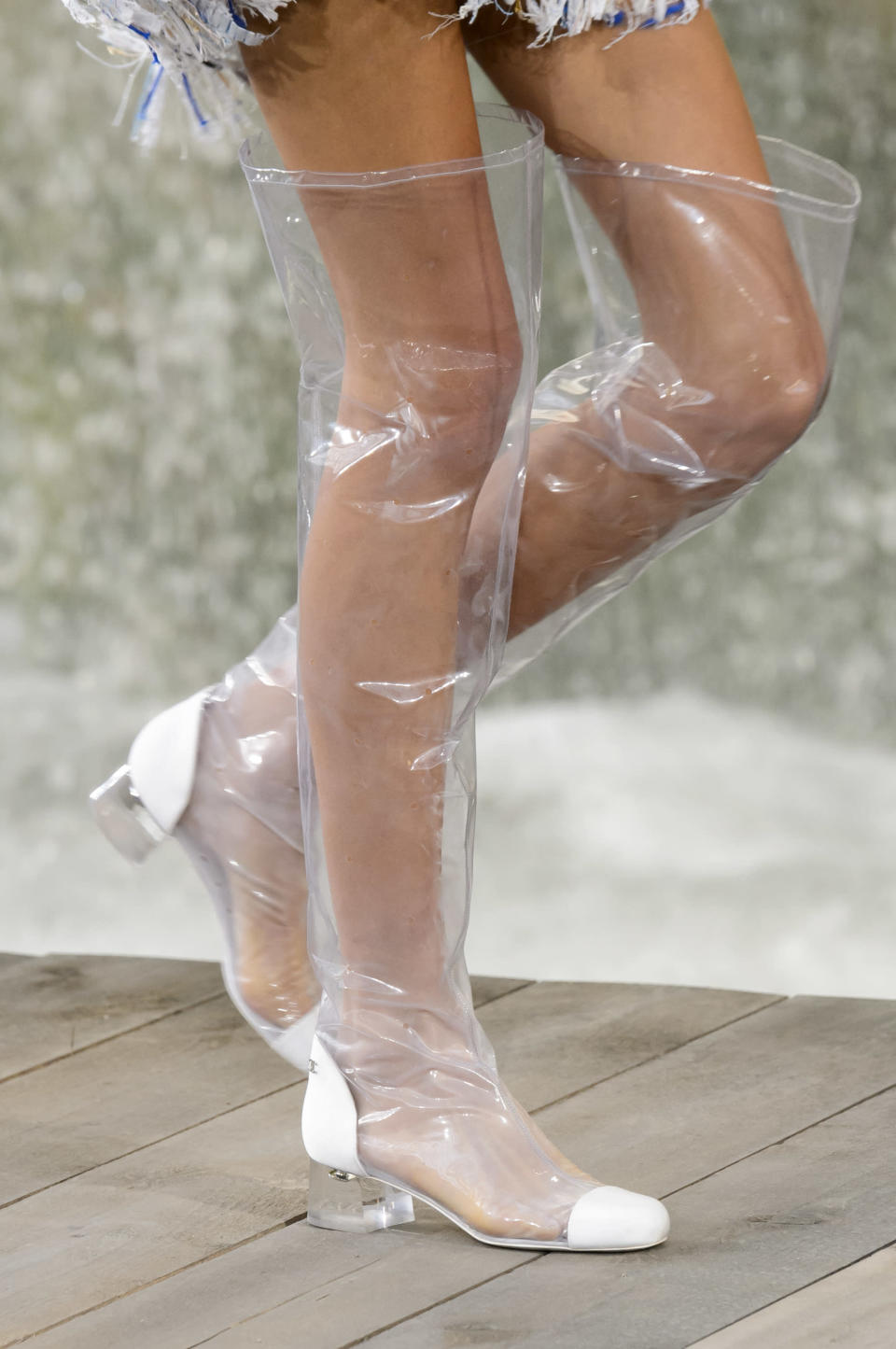 <p><i>Clear PVC thigh-high boots from the SS18 Chanel collection. (Photo: ImaxTree) </i></p>