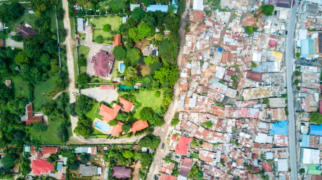 <p>Lush greenery is virtually nowhere to be seen on the poor side in Oyster Bay in Dar es Salaam (MediaDrumWorld/Johnny Miller) </p>