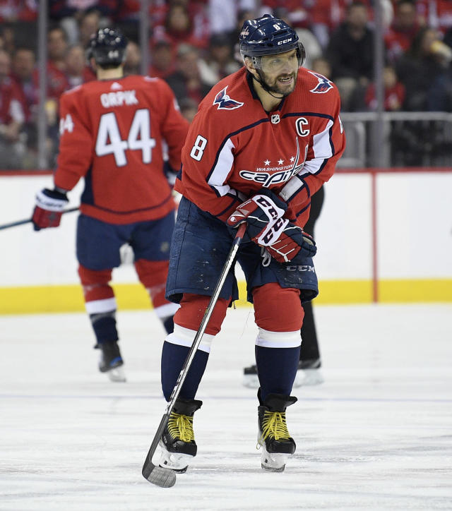 Washington Capitals left wing Alex Ovechkin (8), of Russia, reacts during the first period of the team's NHL hockey game against the Tampa Bay Lightning, Wednesday, March 20, 2019, in Washington. (AP Photo/Nick Wass)
