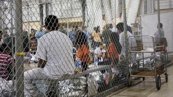 PHOTO: In this June 17, 2018, file photo, provided by U.S. Customs and Border Protection, people who have been taken into custody related to cases of illegal entry into the United States, sit in one of the cages at a facility in McAllen, Texas. (U.S. Customs and Border Protection's Rio Grande Valley Sector via AP)