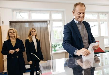 European Council President Donald Tusk casts his vote during parliamentary election in Sopot