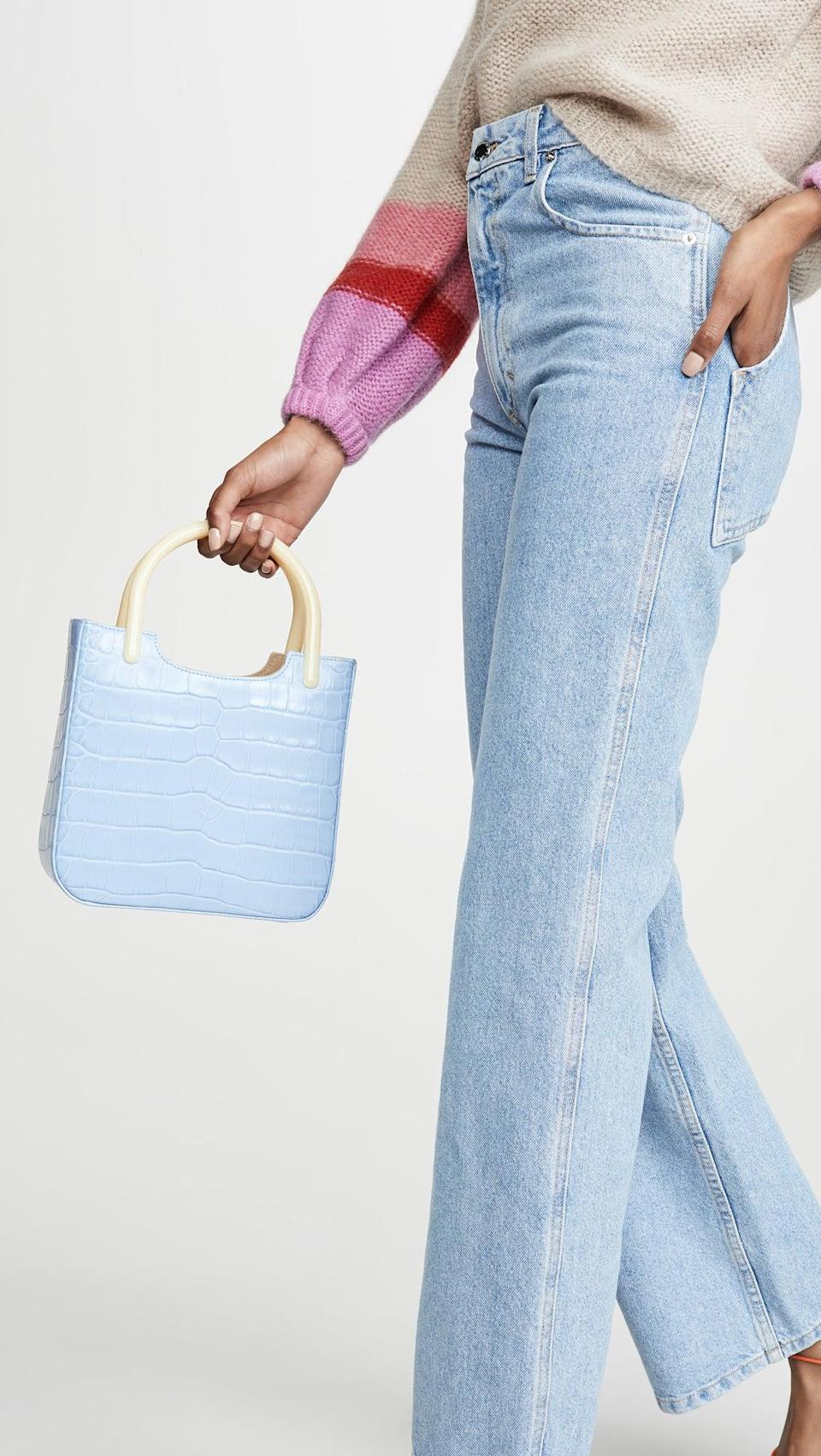 "<p>No one could refuse this adorable <a href=""https://www.popsugar.com/buy/Far-Eric-Bag-527765?p_name=By%20Far%20Eric%20Bag&retailer=shopbop.com&pid=527765&price=688&evar1=fab%3Aus&evar9=36291197&evar98=https%3A%2F%2Fwww.popsugar.com%2Fphoto-gallery%2F36291197%2Fimage%2F46983069%2FBy-Far-Eric-Bag&list1=shopping%2Choliday%2Cwinter%2Cgift%20guide%2Cwinter%20fashion%2Choliday%20fashion%2Cfashion%20gifts&prop13=api&pdata=1"" rel=""nofollow noopener"" class=""link rapid-noclick-resp"" target=""_blank"" data-ylk=""slk:By Far Eric Bag"">By Far Eric Bag</a> ($688).</p>"