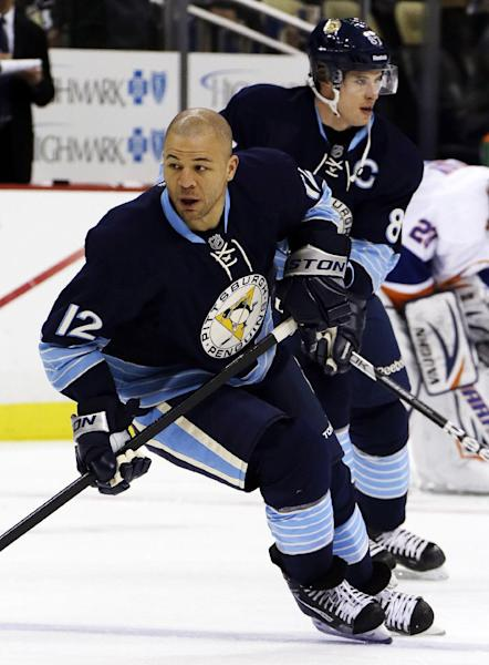 Pittsburgh Penguins' Jarome Iginla (12) and center Sidney Crosby warm up before an NHL hockey game against the New York Islanders in Pittsburgh, Saturday, March 30, 2013. (AP Photo/Gene J. Puskar)
