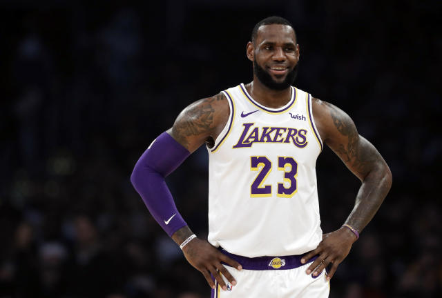 "<a class=""link rapid-noclick-resp"" href=""/nba/teams/lal"" data-ylk=""slk:Los Angeles Lakers"">Los Angeles Lakers</a>' <a class=""link rapid-noclick-resp"" href=""/nba/players/3704/"" data-ylk=""slk:LeBron James"">LeBron James</a> is the AP Male Athlete of the Year once again. (AP Photo/Marcio Jose Sanchez)"