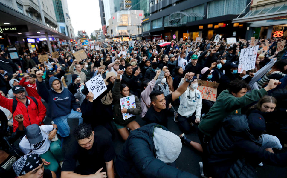 Demonstrators hold placards during a march in central Auckland, New Zealand, Monday, June 1. 2020, to protest the death of United States' George Floyd, a black man who died in police custody in Minneapolis on May 25. Floyd, who after a white police officer who is now charged with murder, Derek Chauvin, pressed his knee into Floyd's neck for several minutes even after he stopped moving and pleading for air. (Dean Purcell/New Zealand Herald via AP