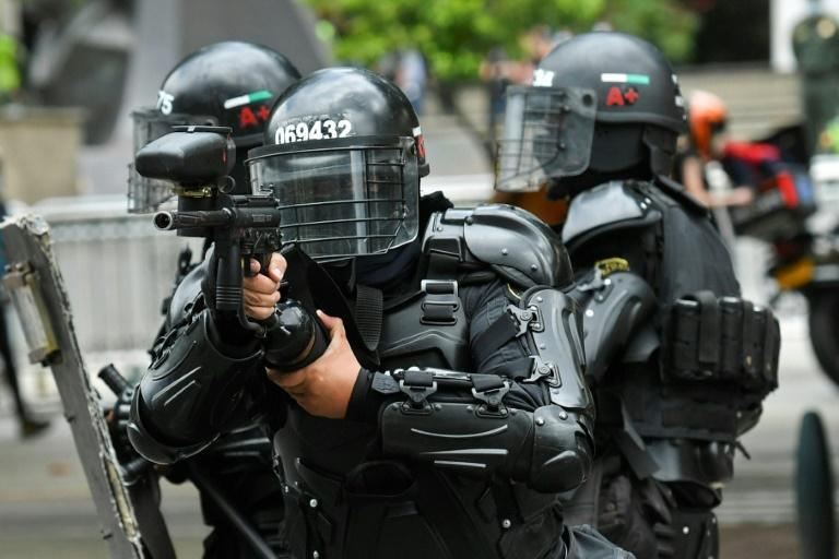 Riot police clash with demonstrators in Medellin, on April 28, 2021