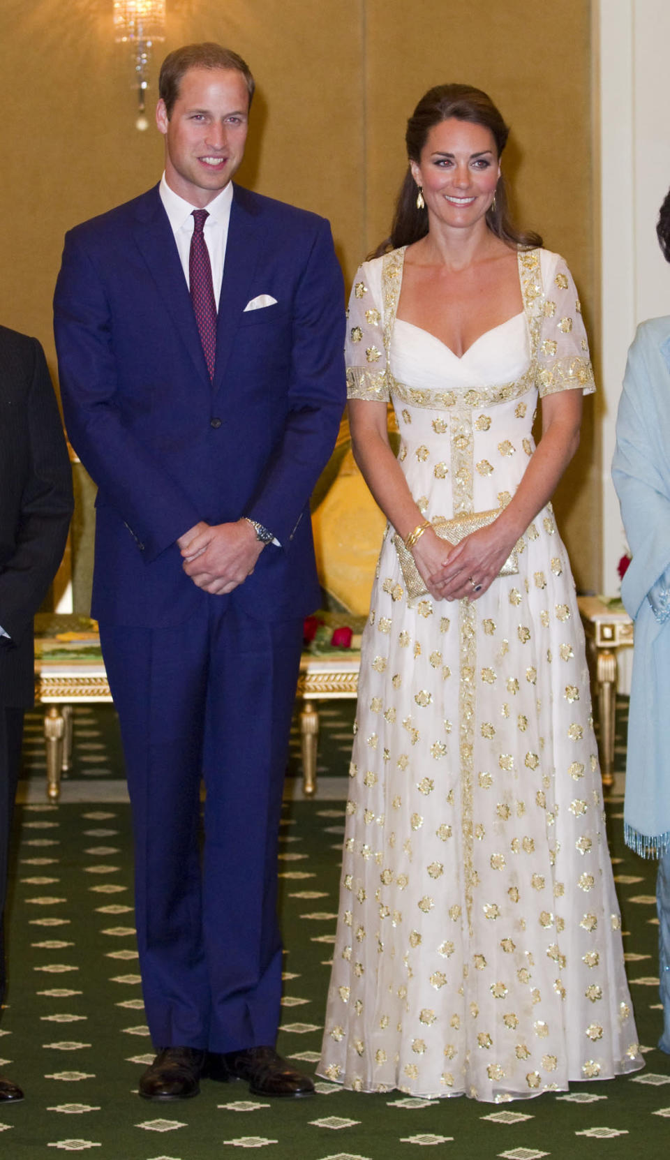 <p>The Duchess attended a dinner with the King of Malaysia wearing a head-turning custom Alexander McQueen gown. Designed in a cream shade with gold embroidery, Kate carried a golden clutch by Wilbur and Gussie. </p><p><i>[Photo: PA]</i></p>
